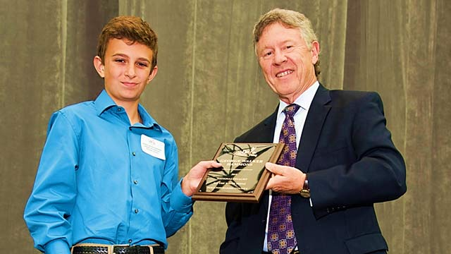Krimmel Intermediate School's Walker Hammons receives award from Do the Write Thing Houston/Harris County Chair Harris County Judge Ed Emmett for being a 2018 National Finalist.